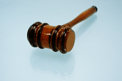 Gavel on glass